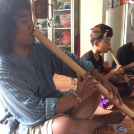 My friend, Balot, playing one of the bamboo flutes